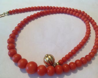 Red coral necklace with gold clasp with ascending beads