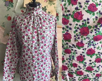 Vintage 1970s Deadstock Floral Ruffle Collar Shirt. Medium/Large. Pink, button up back, ruffle, long sleeve, pink, purple, print.