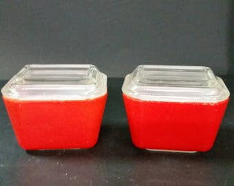 Vintage red  pyrex refrigerator dishes.  Set of 2. With lids. Stackable