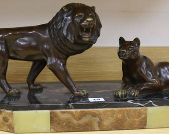 A French Art Deco bronze of a Lion and Lioness   1930