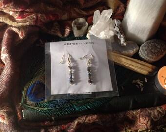 Gorgeous threaded titanium aura crystal earrings