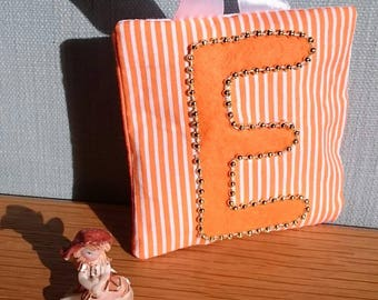 ORANGE stripe tooth fairy pouch door-hanger with ORANGE letter, GOLD beaded border, and orange diagonal pocket on reverse for tooth/coin.