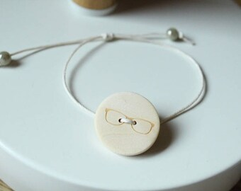off white waxed cotton and wood pattern bezel button adjustable bracelet