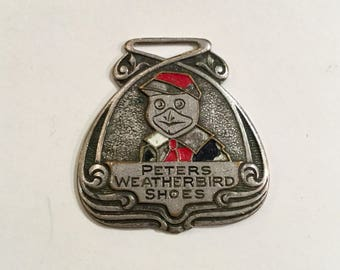 Advertising Watch Fob for Peter's Weatherbird Shoes, St. Louis, Mo, Ca: 1920s.