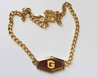 1979 authentic vintage signed GIVENCHY brown enamel on logo gold tone chocker necklace