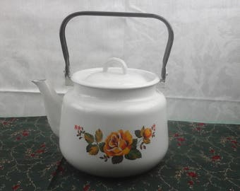 Fantastic white enamelware tea kettle with yellow roses.