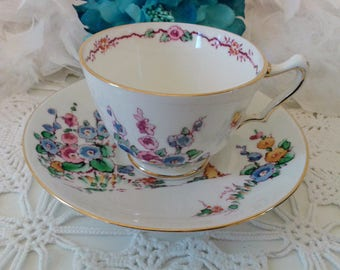 Rare vintage Crown Staffordshire white teacup and saucer 1 with Hollyhock floral pattern, Fine bone China white cup & saucer, England 1920s