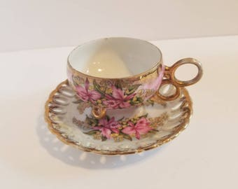 Royal Halsey Very Fine 3 footed teacup and saucer.