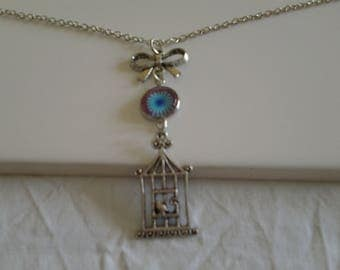 avev cabochon and a bird cage necklace