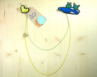 "Brooch necklace ""the little yellow duck and his tired"""