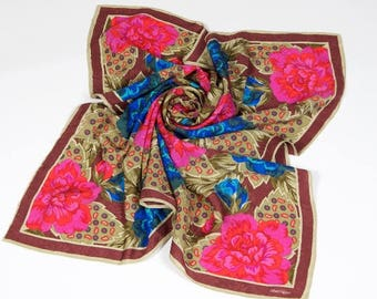 Albert Nippon scarf in silk jacquard floral. Browns, blues, fuchsias and reds. Exquisite style and color.
