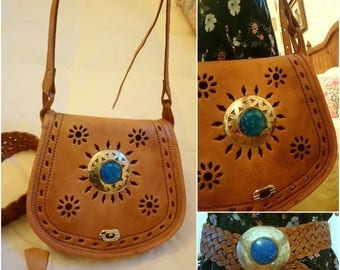 Genuine leather bag with belt.