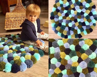 Shades of blue and green PomPoms rug
