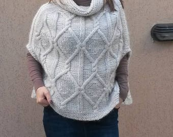 Hand-knitted womens poncho without sleeves and polo collar.hand-knitted blouse.
