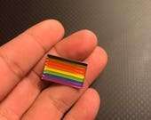 "More Color More Pride 8 Stripe Rainbow Flag LGBT Pride Lapel Pin 1""."