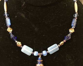 Blue beads with brass/silver