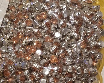Set of 10 3-d Silver set Crystal rhinestones and 5 mm apricot Crystal