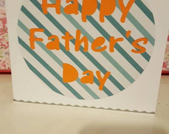 Handmade Father's Day card with bright orange background, teal stripey pattern and silver edge detail. FREE POSTAGE!