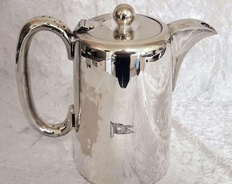 Silver plated coffee pot with engraved company flag of the White Star shipping company.