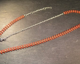 Headband with red brass chain.