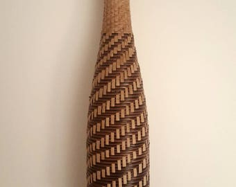 Vintage bottle lined with natural wicker