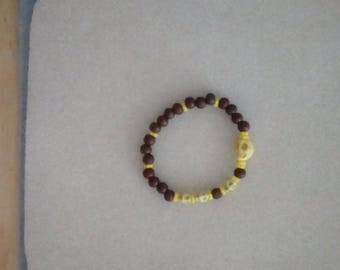 "Ladies 7"" Stretch Acrylic Skulls & Brown Wooden Beaded Bracelet"