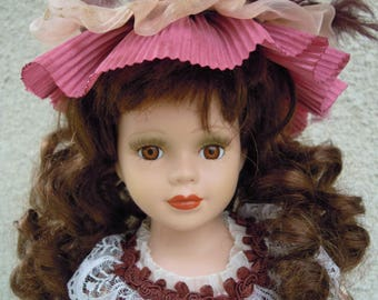 Porcelain doll with soft-body torso. Vintage doll. Large doll on the stand. Victorian collection genuine porcelain doll.