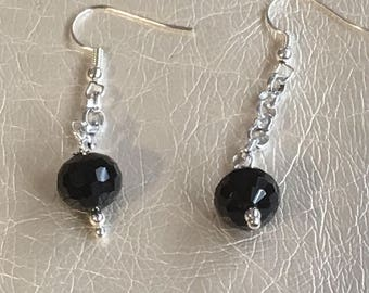 Black dangle earrings Hanging on a silver chain.  On silver ear wires.