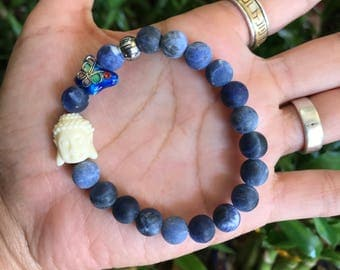 Matte sodalite with Buddha and butterfly