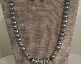Elegant Gray, Black and Gold necklace set.