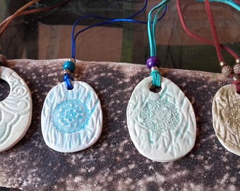 hand-made ceramic pendants