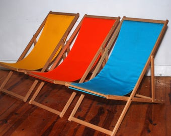 Marine grade wood and canvas folding deck chair.