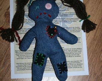 Voodoo doll jeans with brown hair, braids