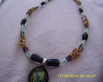 Irish Emerald City (interwoven multi-strand necklace with dichroic pendant)