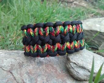 "Survival bracelet double cobra ""rasta"" Paracord."