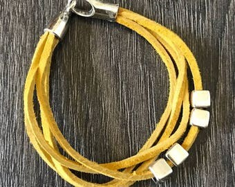 yellow leather bracelet with silver clasp