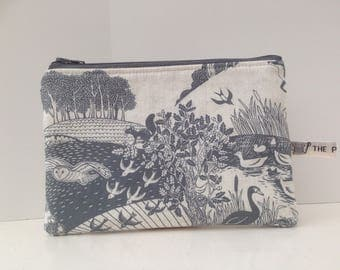 Small makeup bag; zippered pouch; British wildlife, foxes, hares, rabbits, birds, hedgehogs, geese.