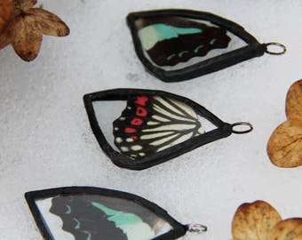 Glass pendant with butterfly wing