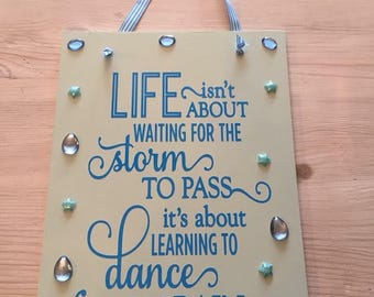 Life isn't about waiting for the storm to pass, its about learning to dance in the rain plaque.