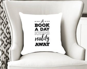 Readers pillow, book a day keeps reality away, bookworm pillow, reading nook decor, funny bookworm gift, book decor ideas, bookworm for her.