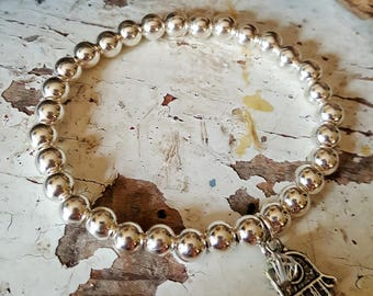 Sterling Siver beaded bracelet with Charm and swarovski crystal
