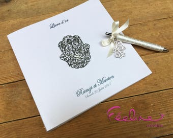 Oriental guestbook personalized with a matching pen