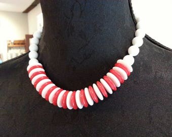 Vintage necklace red and white plastic beads and discs with metal clasp.