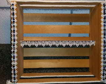 Wooden Shelf, lace and blue beading.