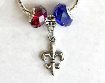 European Bead Style Bracelet. Red & Blue Crystal Beads. Fleur de lis Silver Charm. Silver Snake Chain. FAIS. B.fais101