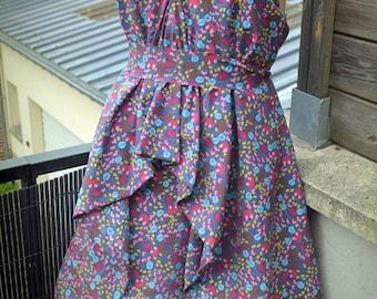 Unique * colored dress with spaghetti straps.
