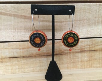 Anheuser-Busch's Shock Top beerings are made from up-cycled beer bottle caps.