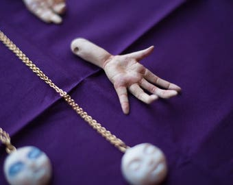 Unusual and detailed polymer clay hand pendant