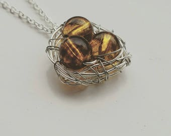Handmade silver Birds Nest necklace on a long silver plated chain.