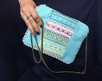 Rafia and woven cotton pouch